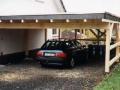 Carport mit Flachdacheindeckung und Schieferortgang